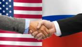 Handshake over american and russian flags — Stock Photo