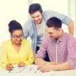 Three smiling architects working in office — Stock Photo #59436917
