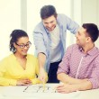 Three smiling architects working in office — Stock Photo #59436923