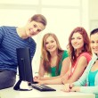 Group of smiling students having discussion — Stock Photo #59478361