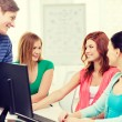 Group of smiling students having discussion — Stock Photo #59478711