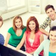 Group of smiling students having discussion — Stock Photo #59478805