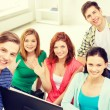 Group of smiling students waving hands at school — Stock Photo #59478999