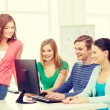 Group of smiling students having discussion — Stock Photo #59479019