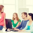 Group of smiling students having discussion — Stock Photo #59479101