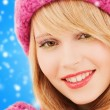 Close up of smiling young woman in winter clothes — Stock Photo #59486423