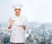 Smiling female chef with tablet pc computer — Stock Photo