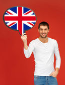 Smiling man with text bubble of british flag — Stock Photo