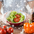 Close of male hands holding bowl with salad — Stock Photo #59658973