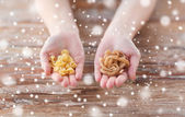 Close up of hands with different pasta variations — Stock Photo