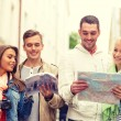 Group of friends with city guide, map and camera — Stock Photo #59665095