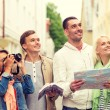 Group of friends with city guide, map and camera — Stock Photo #59665119