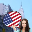 Smiling woman with text bubble of american flag — Stock Photo #59666299