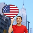 Smiling man with text bubble of american flag — Stock Photo #59666315