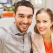 Happy couple taking selfie in mall or office — Stock Photo #59669439