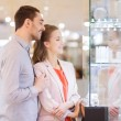 Couple looking to shopping window at jewelry store — Stock Photo #59669577