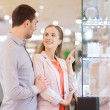 Couple looking to shopping window at jewelry store — Stock Photo #59669597