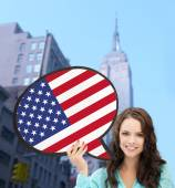 Smiling woman with text bubble of american flag — Foto de Stock