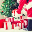 Close up of santa claus with presents — Stock Photo #59988841