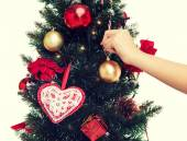 Close up of woman with christmas tree decoration — Stock Photo