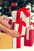 Close up of woman with presents and christmas tree — Foto Stock