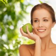 Smiling young woman with green apple — Stock Photo #60050021
