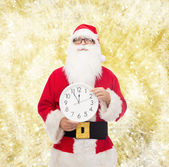Man in costume of santa claus with clock — Zdjęcie stockowe