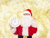 Man in costume of santa claus with clock — Foto Stock
