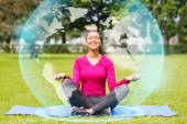 Smiling woman meditating on mat outdoors — Stock Photo