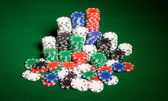 Close up of casino chips on green table surface — Stock fotografie
