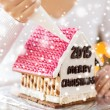 Close up of woman making gingerbread houses — Stock Photo #60137417