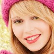 Close up of smiling young woman in winter clothes — Stock Photo #60137663