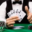 Poker player with cards and chips at casino — Stock Photo #60138299