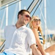 Smiling couple sitting on yacht deck — Stock Photo #60138625