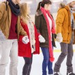 Happy friends on skating rink — Stock Photo #60138931