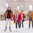 Happy friends on skating rink — Stock Photo #60138933