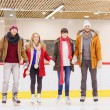 Happy friends on skating rink — Stock Photo #60138943