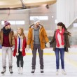 Happy friends on skating rink — Stock Photo #60138947