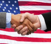 Close up of handshake over american flag — Foto Stock