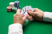 Poker player with cards and chips at casino — 图库照片