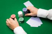 Holdem dealer with playing cards and casino chips — Stock Photo