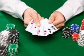 Poker player with cards and chips at casino — Stok fotoğraf