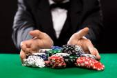 Poker player with chips at casino table — Foto de Stock