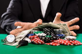 Poker player with chips and money at casino table — Foto de Stock