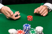 Poker player with dice and chips at casino — Foto de Stock