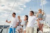 Smiling friends sailing on yacht — Foto de Stock