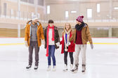 Happy friends on skating rink — Photo