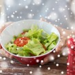Close of male hands holding bowl with salad — Stock Photo #60140091
