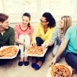 Five smiling teenagers eating pizza at home — Stock Photo #60140521