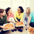 Five smiling teenagers eating pizza at home — Stock Photo #60140547